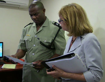 Manager of the NWS Caribbean Tsunami Warning Programme, Mrs. Christa von Hillerbrandt-Andrade pictured here in consultation with Chief Inspector St. Clair Armory of the Royal Virgin Islands Police Force during her site verification visit