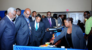 Delegates touring the exhibition following the Opening Ceremony of the Ninth Comprehensive Disaster Management Conference, at Melia Nassau Beach Resort, November 30.  From left: The Most Hon. P J Patterson, former Prime Minister of Jamaica; The Hon. Adriel Brathwaite, Chairman, CDEMA Council; and the Hon Arnold Forbes, Minister of State, Ministry of Works and Urban Development (at centre).  (BIS Photo/Kemuel Stubbs)