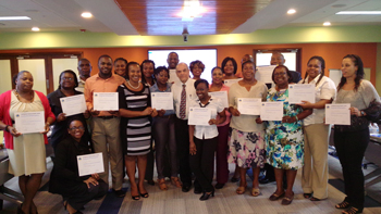 Bragging Rights! Participants proudly display their certificates in the company of training facilitator, David Logan