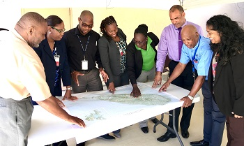 Members of the 4 regional agencies and representatives from National Disaster Offices getting ready for the exercise (from left to right: Philmore Mullin (NDC, Antigua & Barbuda); Lorraine Francis (CARPHA), Mandela Christian (CDEMA), Nadine Bushell (CARICOM IMPACS), Claricia Stephens (NDC, St. Kitts & Nevis), Captain Brian Roberts (RSS), BG General (R) Earl Arthurs (CDEMA) and Joanne Persad (CDEMA).
