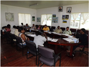 Ms. Althea Daniels-Stuart (at the head of the table) conducting lecture presentation with the participants of the Shelters and Shelter Management Workshop