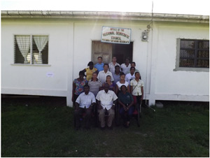 Seated left to right – Assistant Regional Executive Officer Region 8 is Mr. Shameer Arjoon, at centre is Mr. Mark Crawford and to his right is Shelter Management Instructor Ms. Althea Daniels-Stuart with the participants in standing in at the back