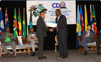 Mr. Ronald Jackson, Executive Director, CDEMA (left) presenting the cheque to the Hon. Vaden Williams, Minister of Home Affairs, Transportation and Communication with responsibility for disaster management, Turks and Caicos Islands.