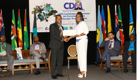 Dr. Evangeline Inniss-Springer, Deputy Director, Department of Disaster Management of the British Virgin Islands accepting cheque being presented by Mr Ronald Jackson, Executive Director, CDEMA.