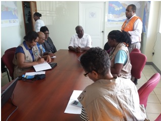 Members of the COST meeting with Minister Francois Anick Joseph and Madame Jean Baptiste, Director of the CPD.