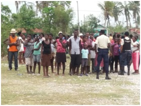 Some of the Les Cayes residents who gathered for the distribution of family packages by the CARICOM contingent.