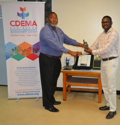 Clive Murray of CDEMA handing over Emergency Telecoms Equipment to Philmore Mullins of NODS