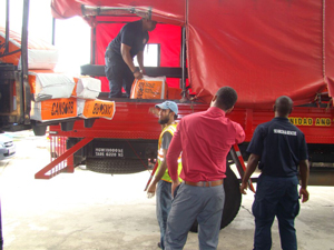 Members of the Trinidad and Tobago Fire Service load Cansorb onto their truck