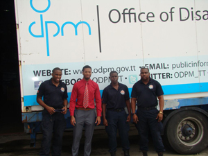 Kevon Campbell of the ODPM with representatives of the Trinidad and Tobago Fire Service