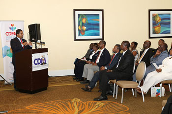 The Hon. Peter Turnquest, Deputy Prime Minister and Minister of Finance, Government of The Bahamas delivering key note address at the launch of CDM10