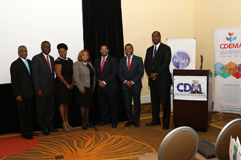 L-R: Ambassador Joshua Sears, Senior Policy Advisor, Office of the Prime Minister, Government of The Bahamas; Mr Simon Wilson, Financial Secretary, Ministry of Finance, Government of The Bahamas; Ms Maria Corbin, Executive Assistant, CDEMA; Ms Tanya Woodside, Area Coordinator and Membership Chair, Rotary Clubs of The Bahamas; Hon. Peter Turnquest, Deputy Prime Minister and Minister of Finance, Government of The Bahamas; Mr Ronald Jackson, Executive Director, CDEMA and Captain Stephen Russell, Director, NEMA, Government of The Bahamas.