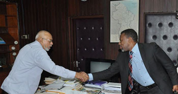 President Donald Ramotar is greeted by Ronald Jackson, Executive Director, Caribbean Disaster Emergency Management Agency (CDEMA)